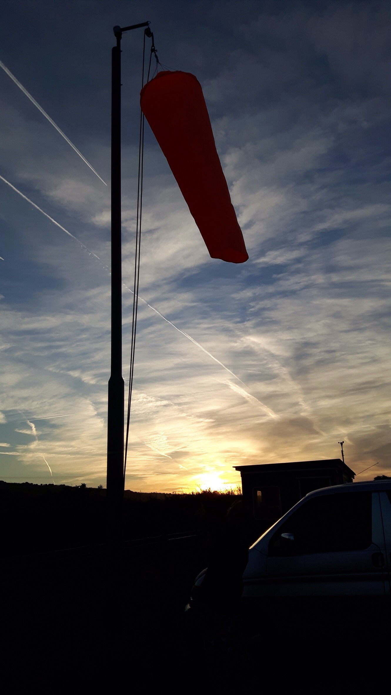 Limp windsock at sunrise